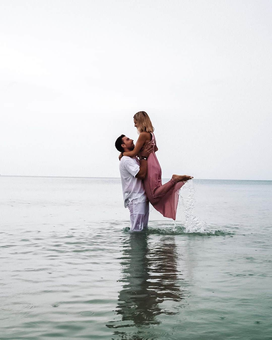 man carrying woman in the sea