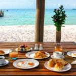 good breakfast on table beach view
