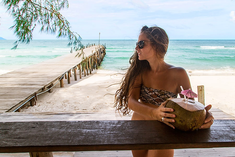 Girl with coconut at cocobeach bar